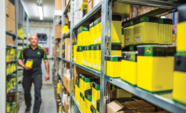 employees gathering parts walks between stocked shelves
