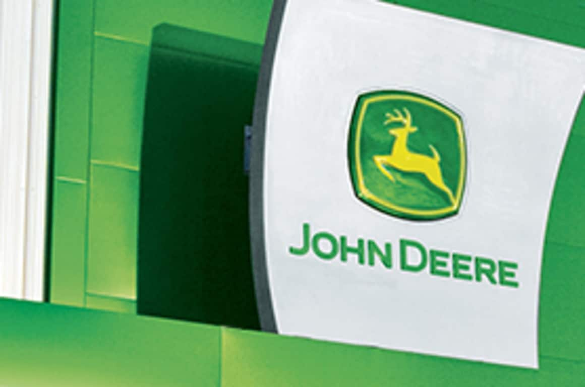 A John Deere sign at the front of a dealership