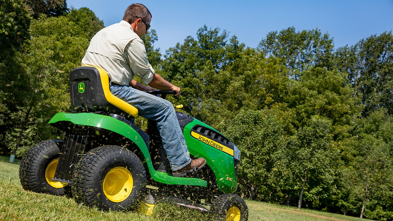 man riding a 100 series mower