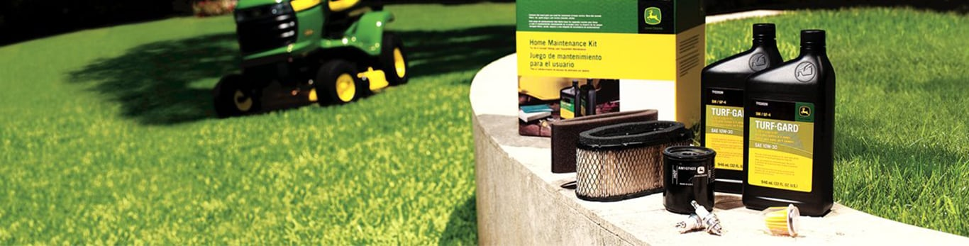 John Deere Home Maintenance Kit set out on a bench in a yard