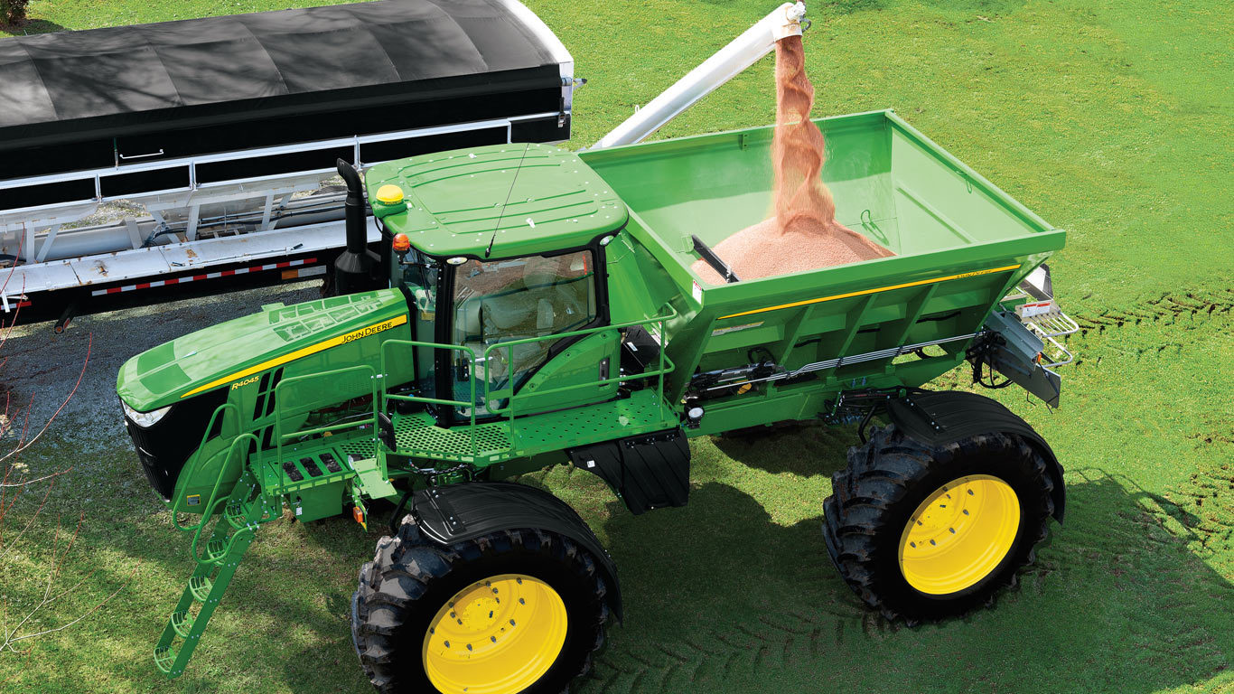 image of seed being poured into a dn485 dry spinner spreader