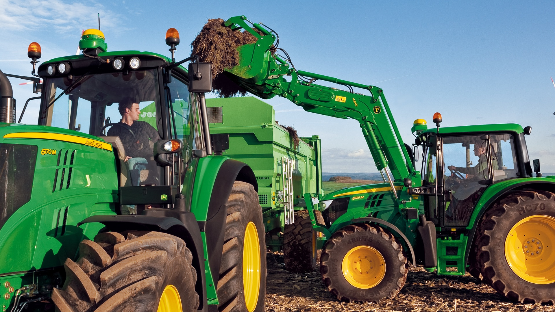 image of tractor working with attachments in field