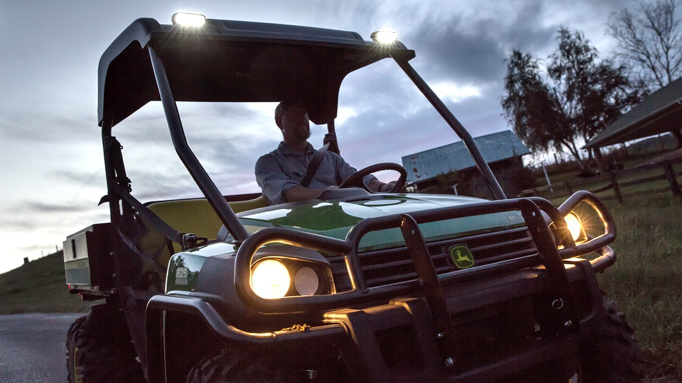 image of Gator™ UV with lights on driving at dusk